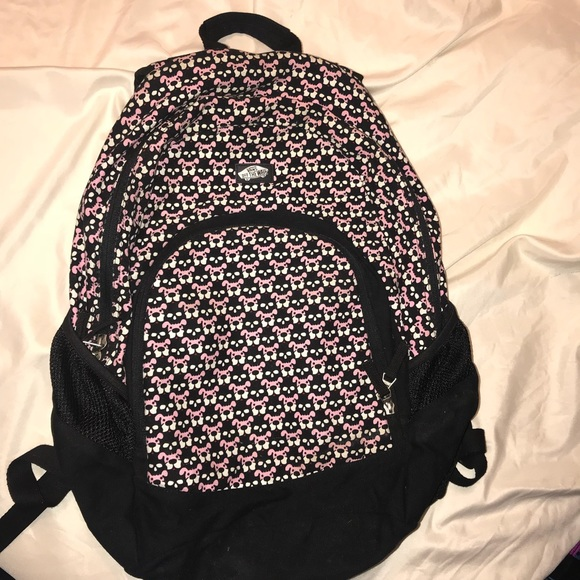 08495a1999 Vans Off The Wall Pink puppy Black skull backpack.  M 5b10f1ad3c9844a5c0c2b6d5